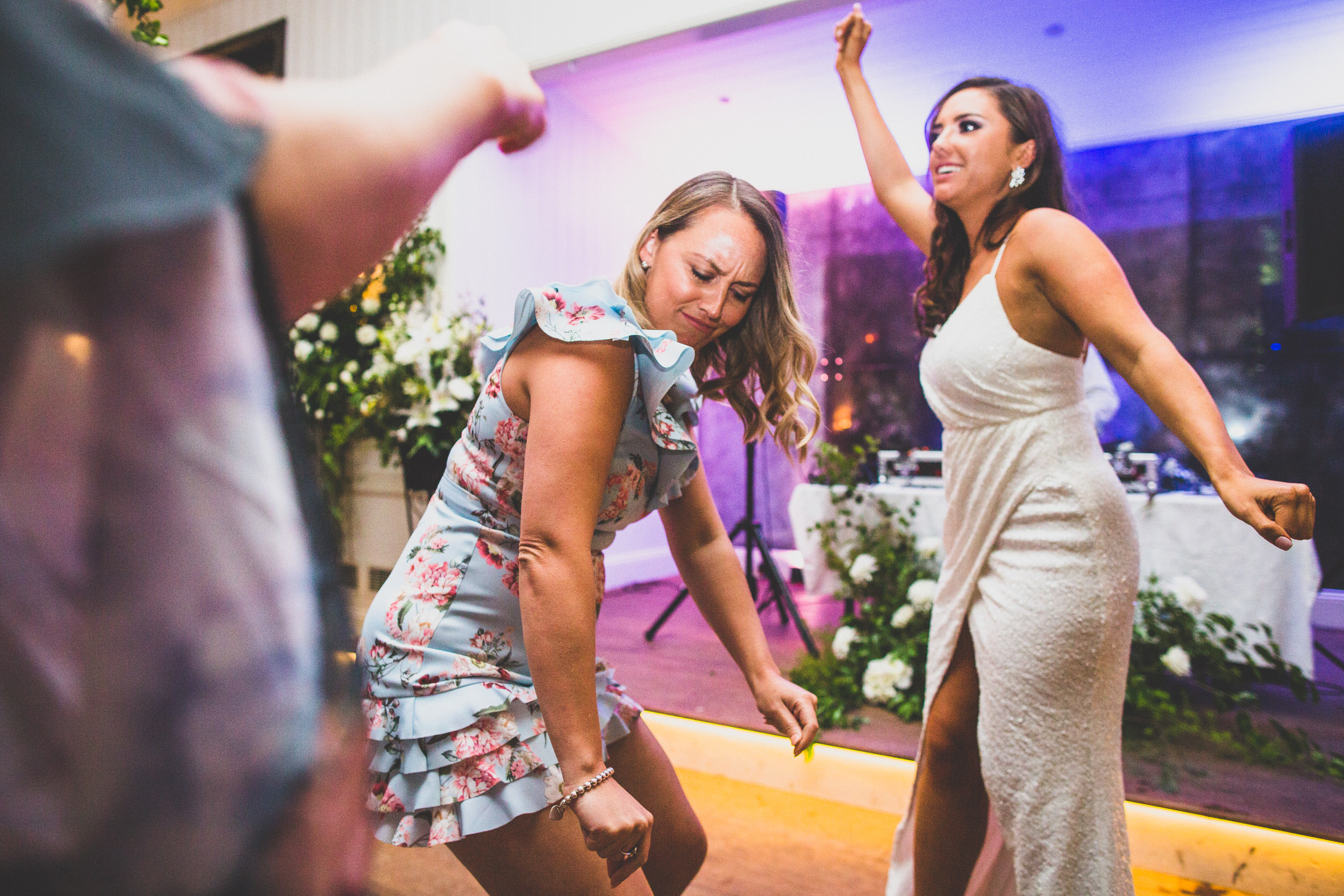 letting go on the dance floor at a wedding in NSW