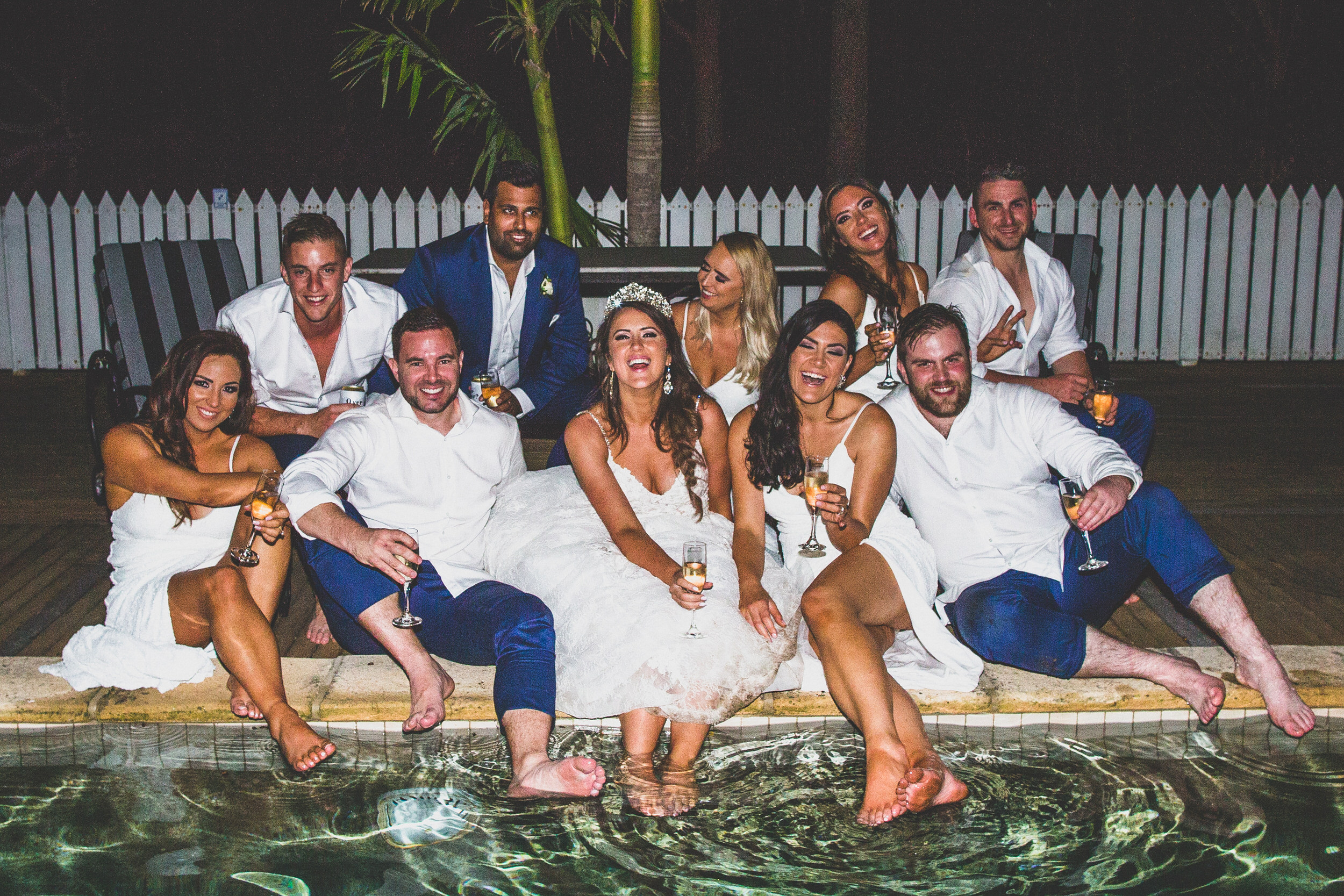 Wedding party Goals - hanging by the pool after a fabulous wedding whilst drinking champagne