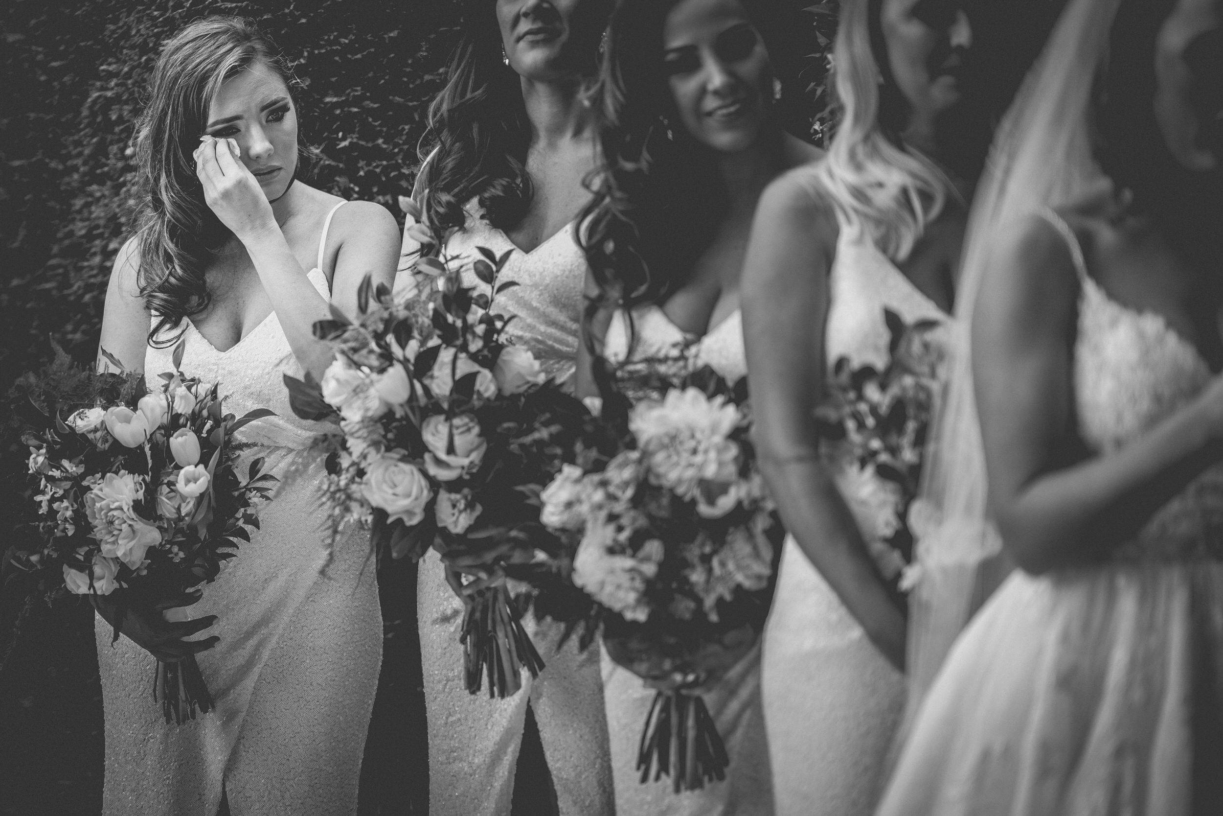 Documentary photography. Black and white of the bridesmaid shedding a tear.