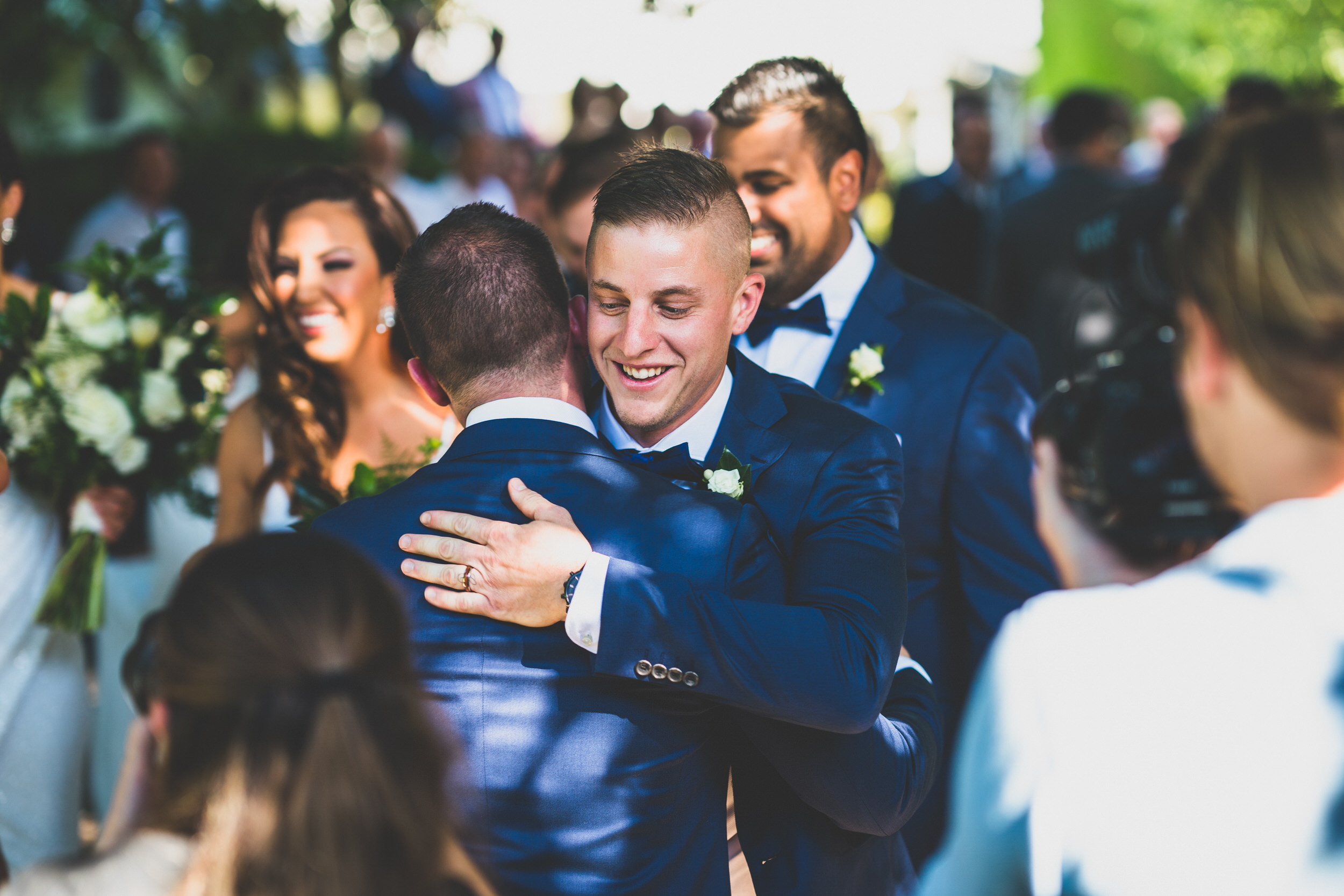 The groom's best friend and best man congratulating him