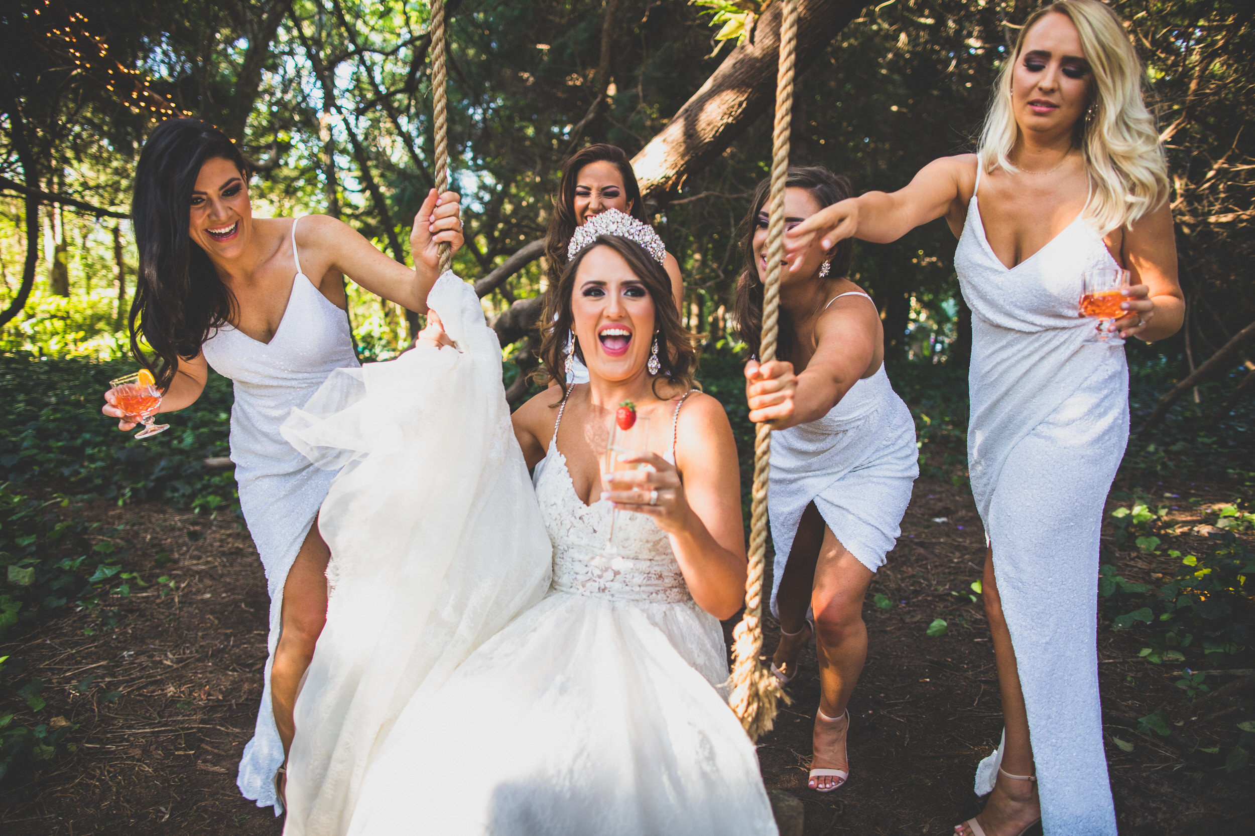 bridal party goals - swinging whilst drinking champagne