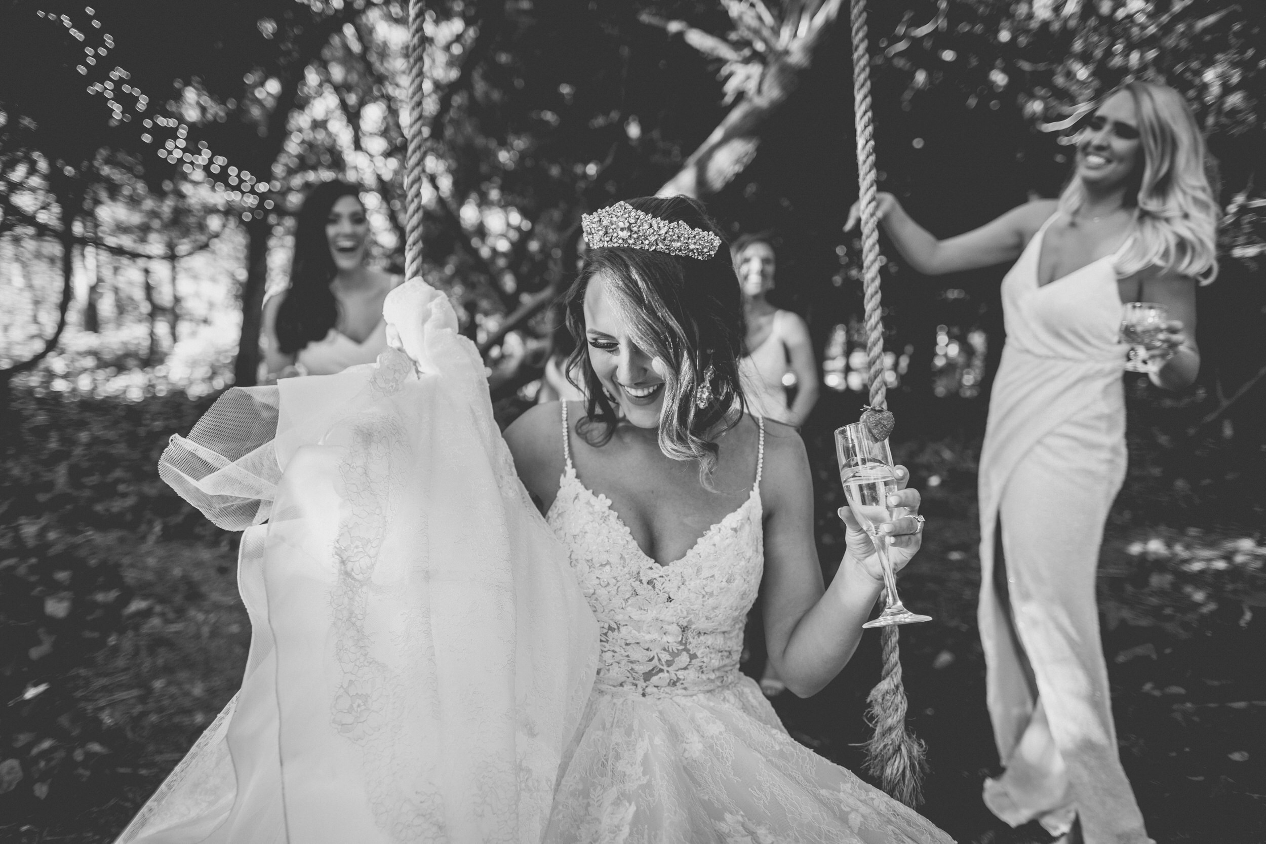 Bride, Rachel, swinging surrounded by her bridesmaids