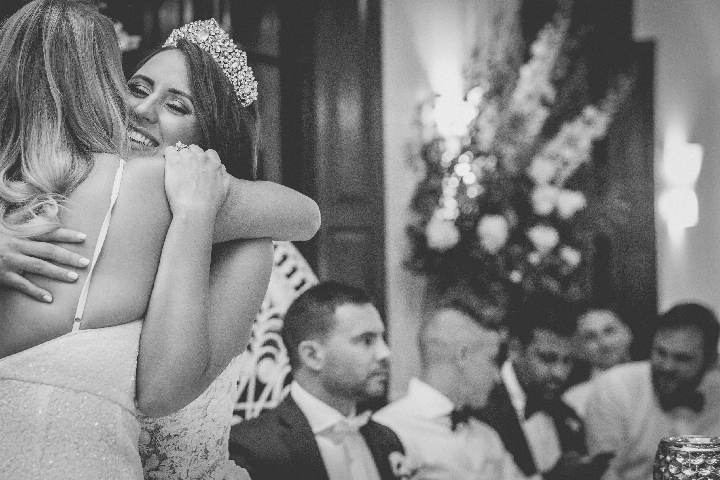 the bride hugging her best friend and maid of honour at a Jaspers wedding