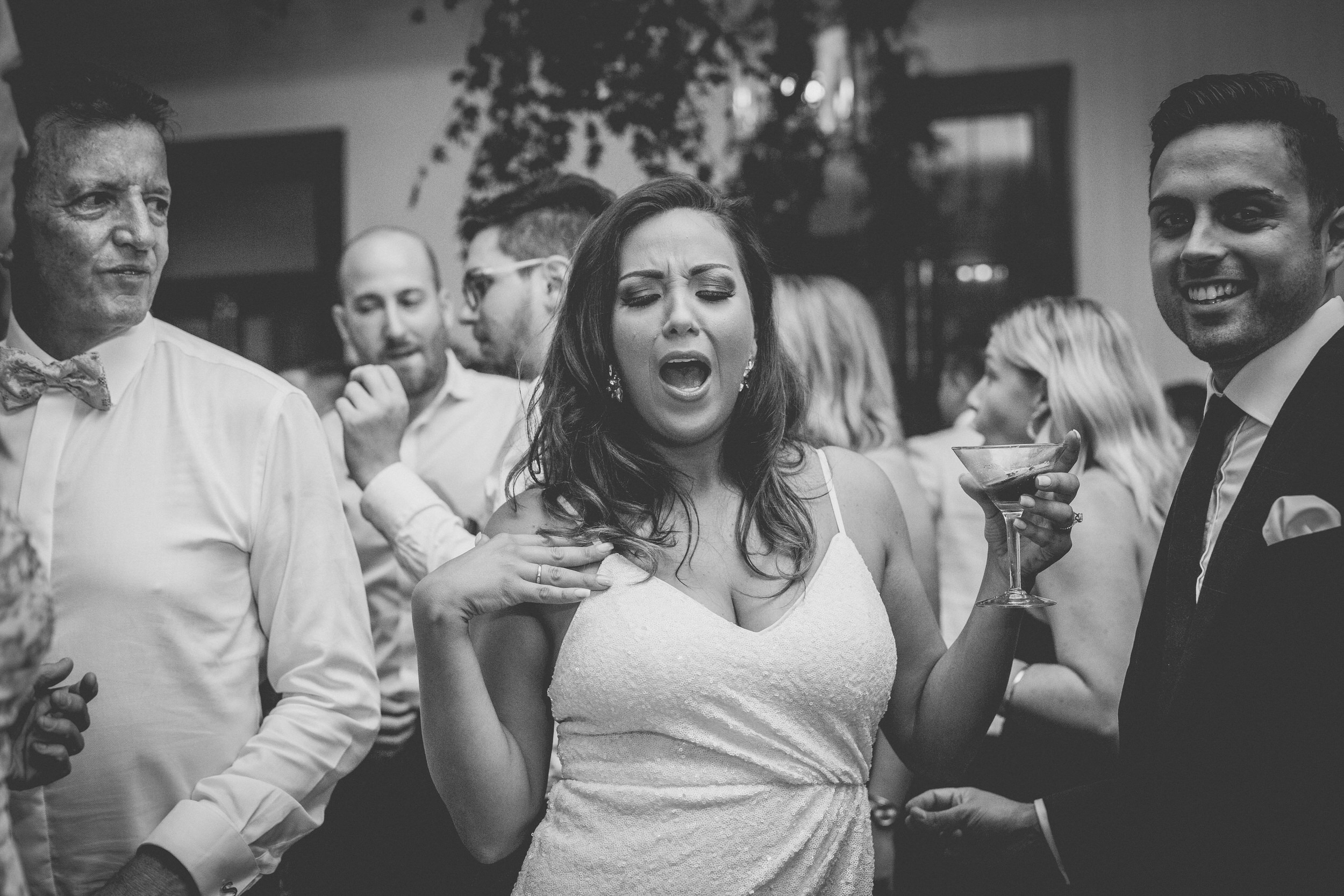 A bridesmaid letting loose on the dance floor