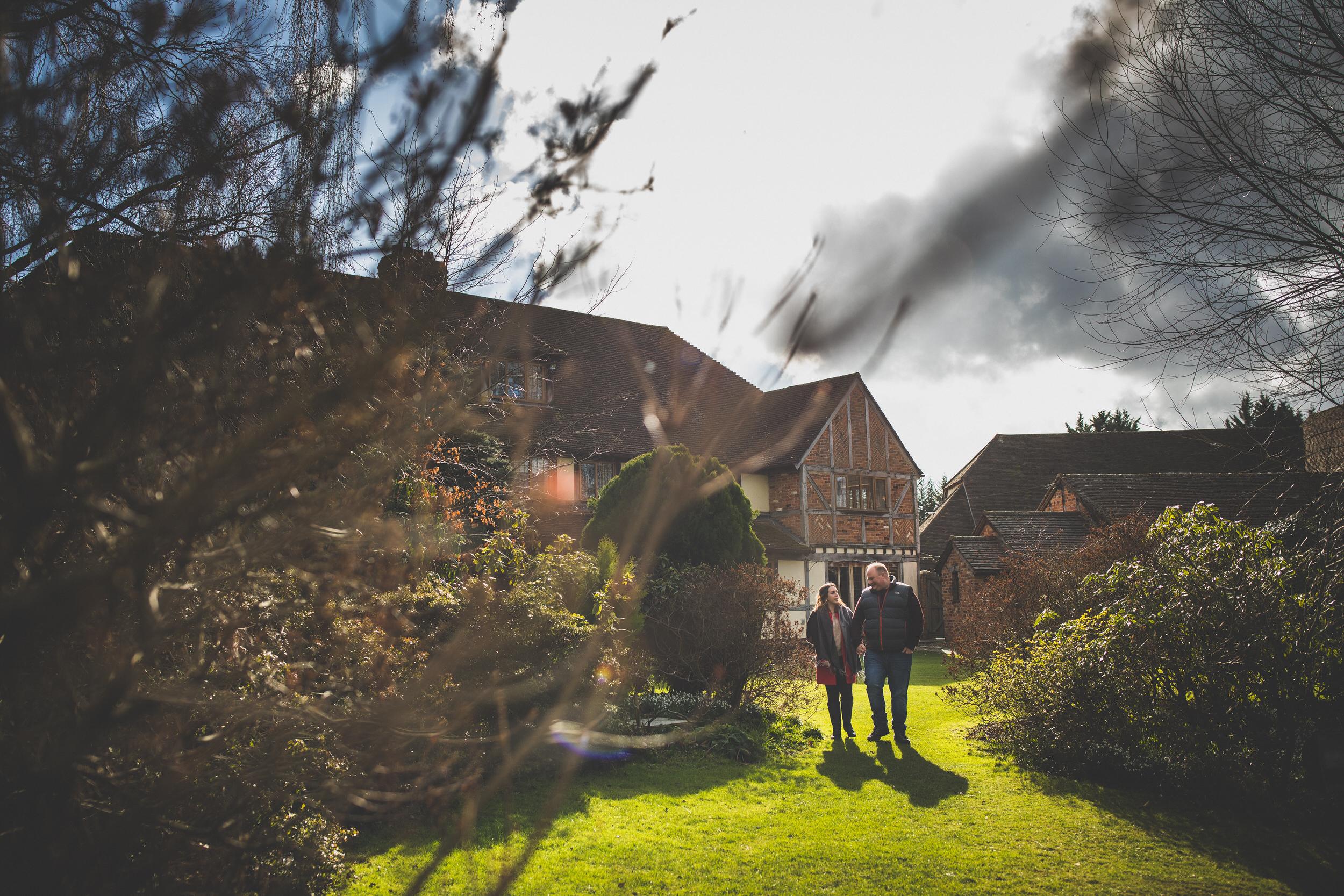walking through the gardens during an engagement shoot