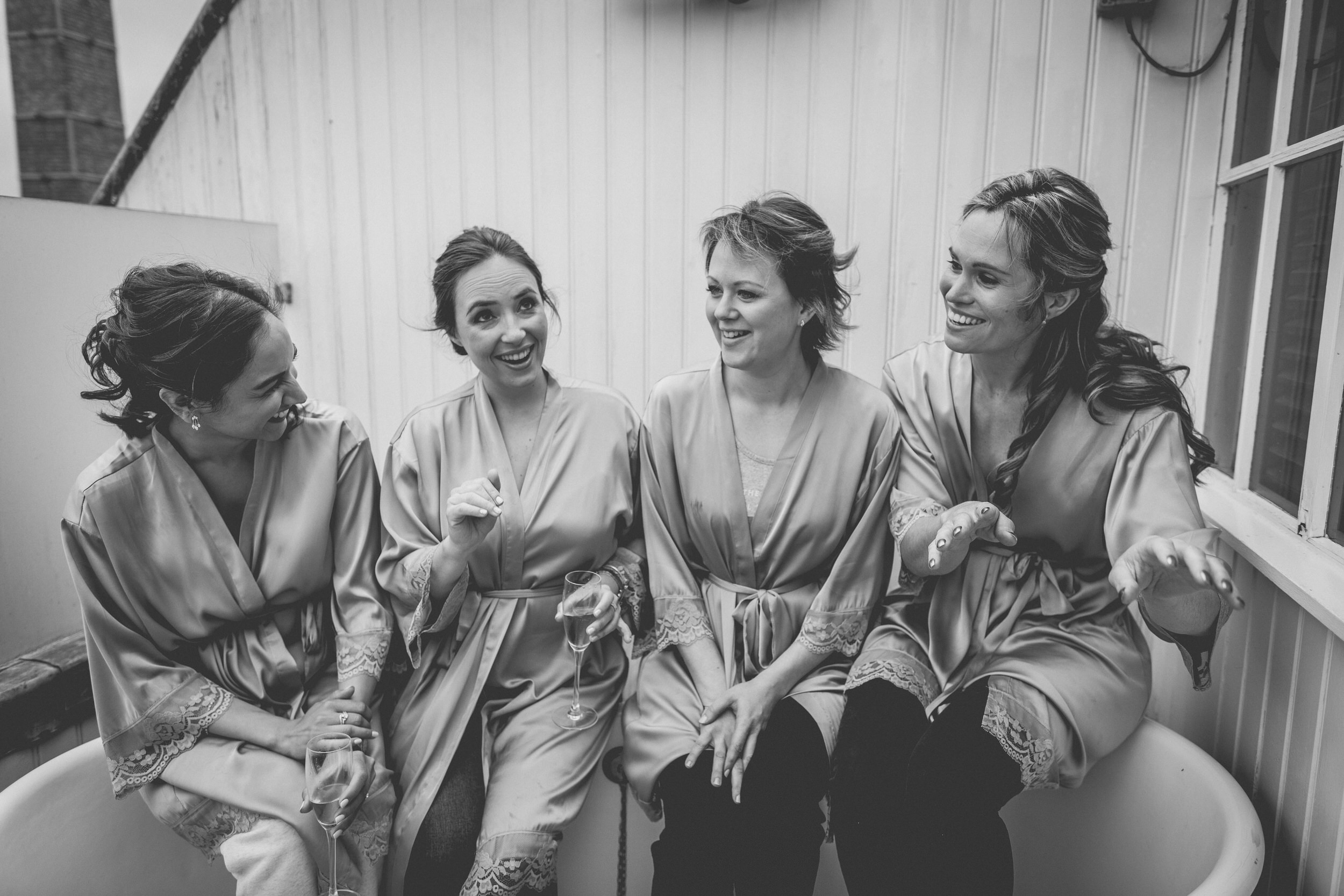bridesmaids in a bathtub