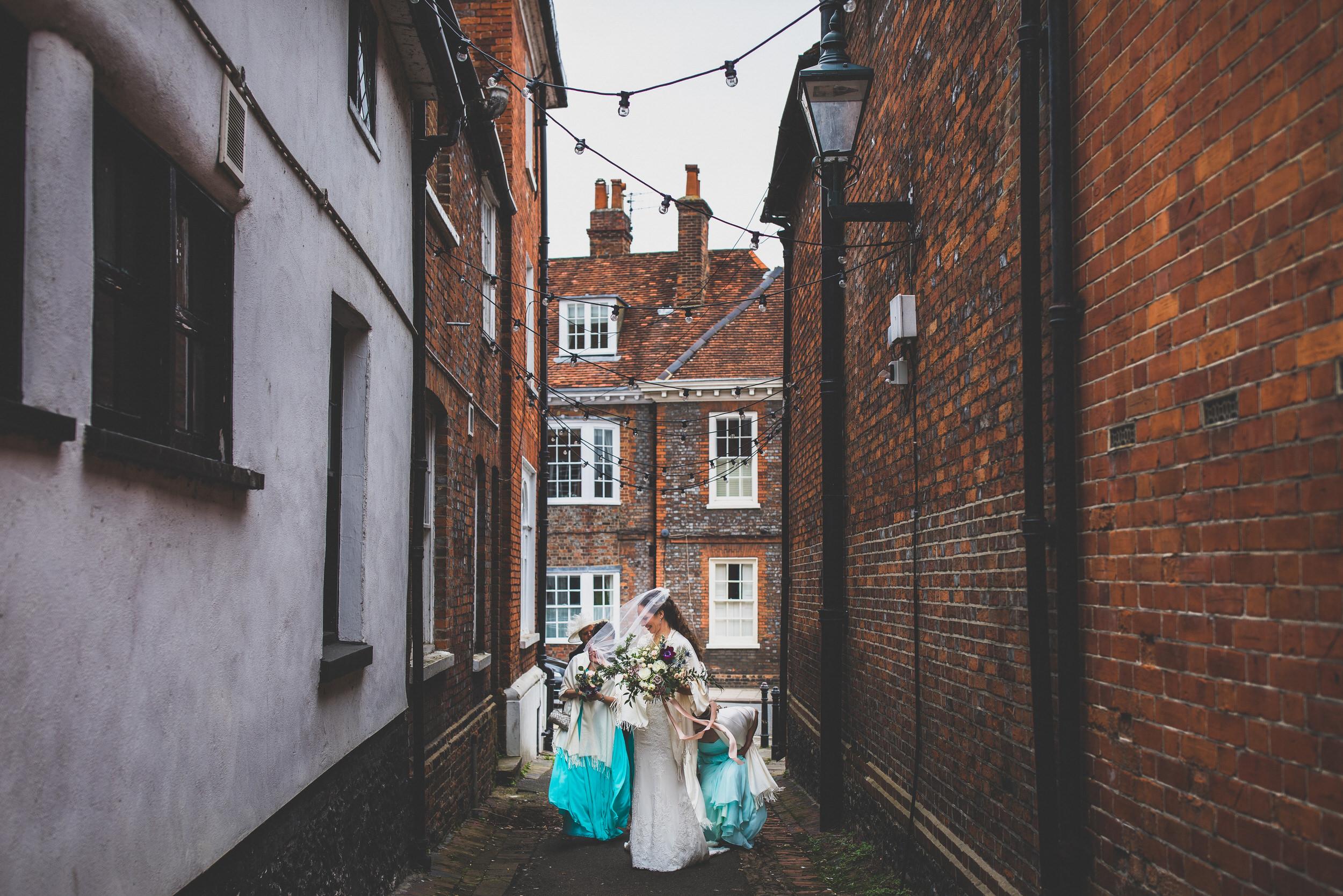 walking through inner city alleyway