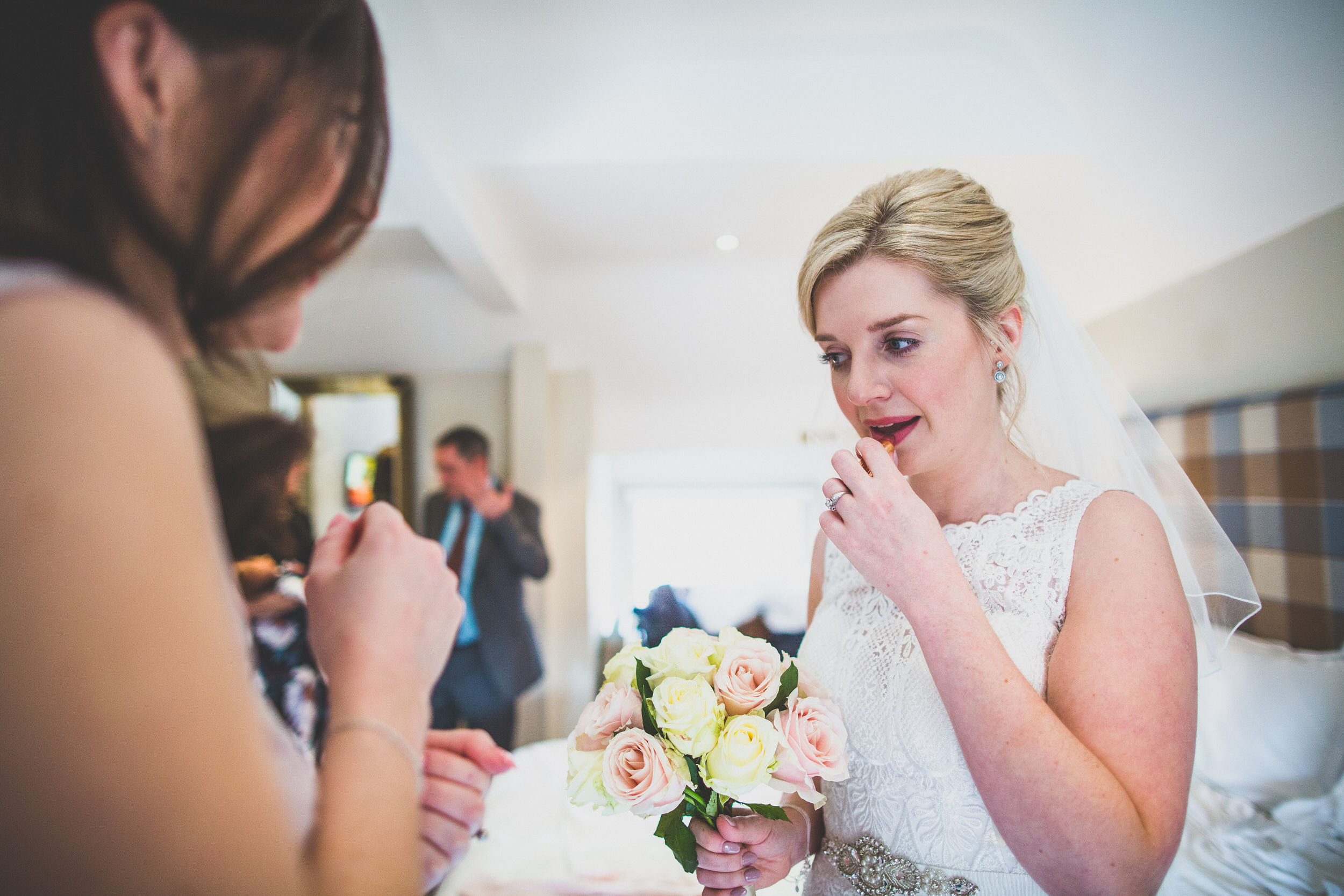 lipstick touch ups on her wedding day