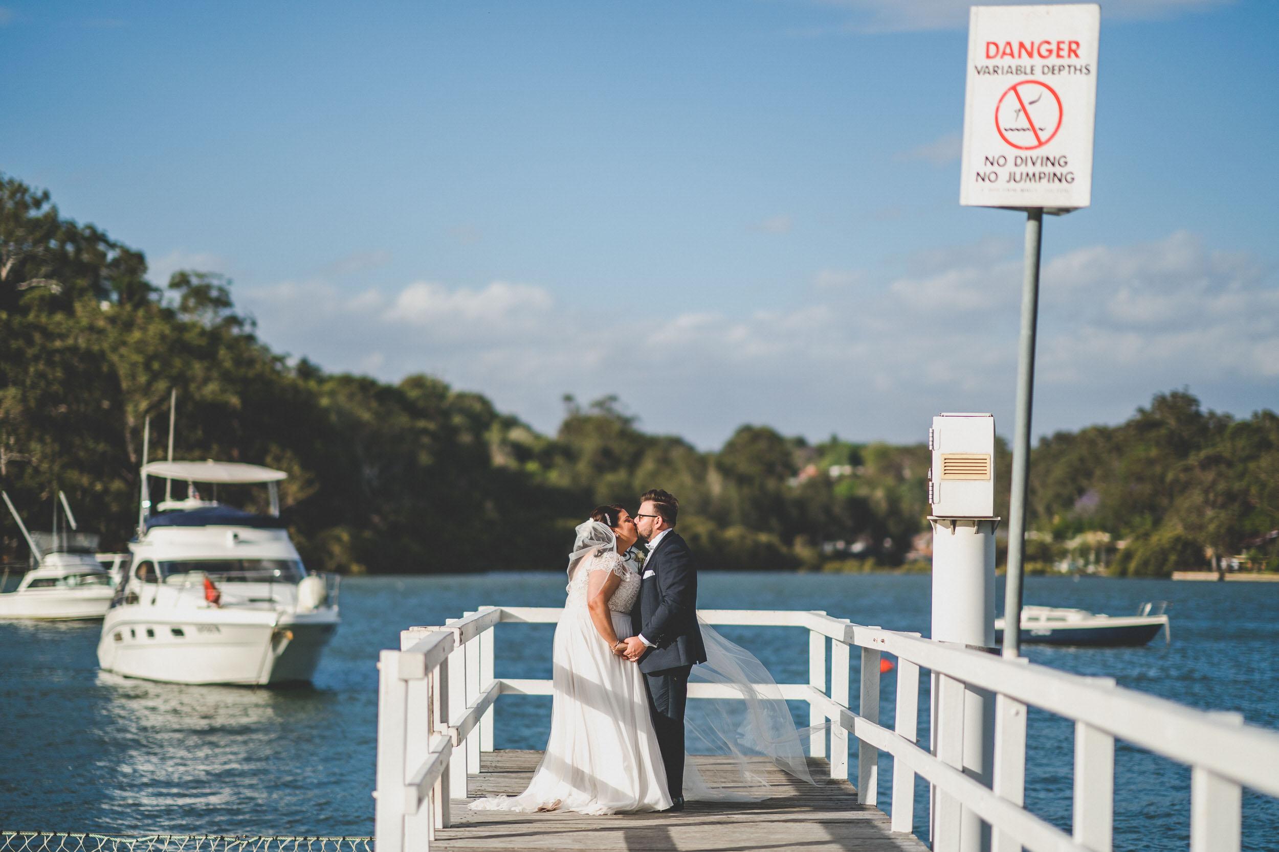 Doltone house bride and groom on a wharf