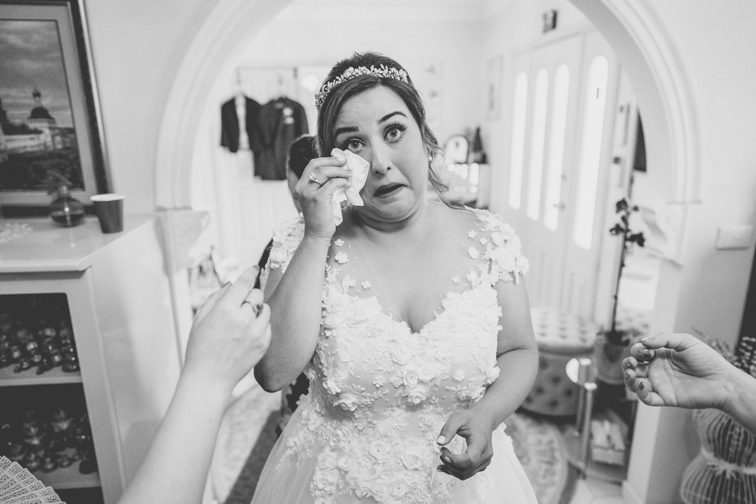 emotional bride during preparations