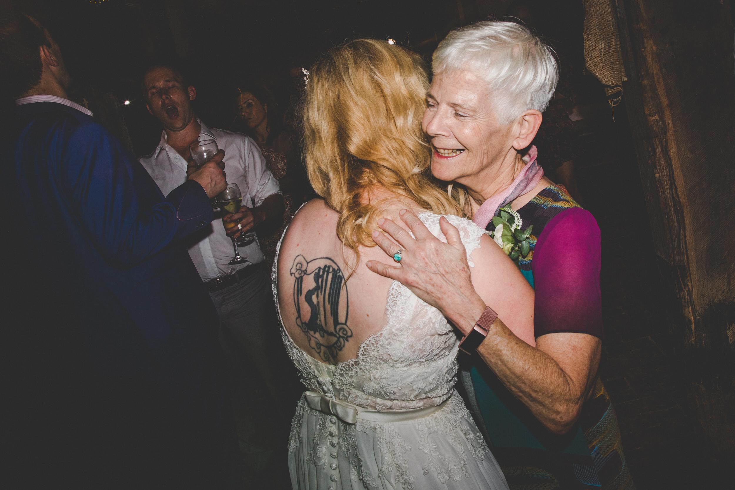 hugs on the wedding dance floor
